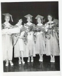 Class graduation photo of Judi Fowler, Armida DeSantis, Kathy Ryan, Margie James, and Danilee Gorman